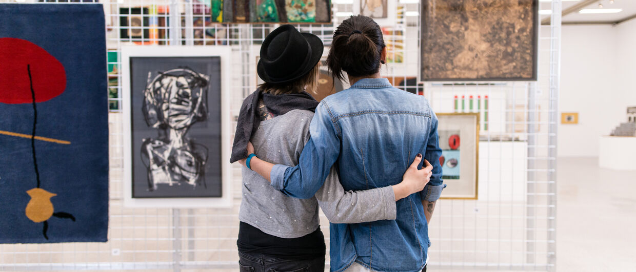 Couple admires exhibition